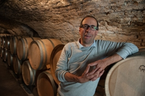 Jacques Carillon in his cellar was in good spirits