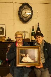 Marie-Christine and Maerie-Andrée with a photo of their father Georges