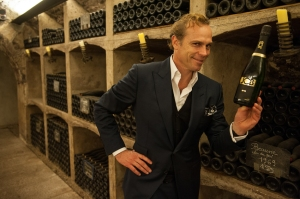 """JCB fooling about with his new Cremant, """"21"""""""