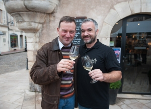 Olivier Lamy and Nicolas Rossignol celebrate passing unnoticed among the crowds