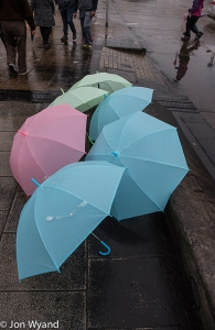 It had been raining for several days but that was about to end, sadly for this umbrella salesman.